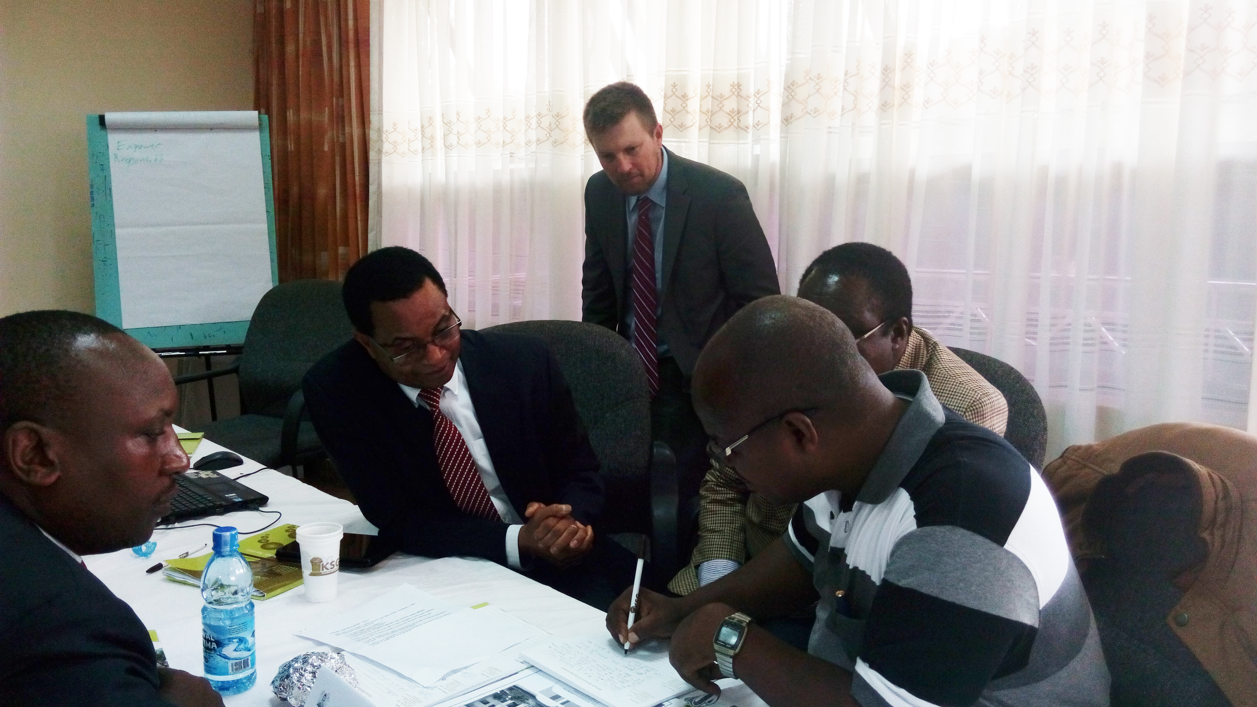 Patrick Shepherd, OGE Senior Instructor, works with senior faculty at Kenya School of Government